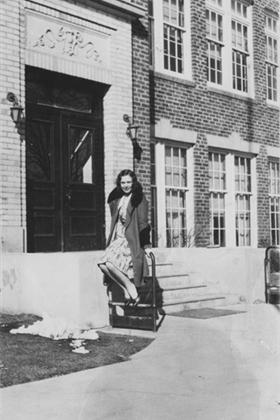 Lucille Cundell in front of the high school building