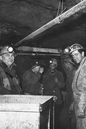 Group of men in the interior of the Eagle Mine