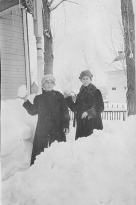 Grandma Reese and Maggie holding snowballs
