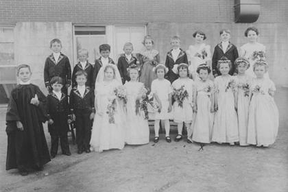 Children in costume for a mock wedding