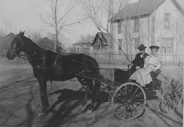 Martha Brown and Rig Franks in a horse-drawn buggy